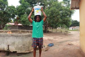 The Water Project: Masoila, 28 Conteh Street -  Boy Carrying Water