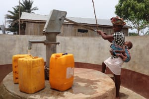 The Water Project: Tombo Lol, next to Agricultural Center -  Woman At Restrictd Well