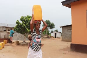 The Water Project: Tombo Lol, next to Agricultural Center -  Woman Carrying Water