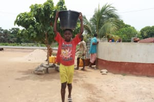 The Water Project: Tombo Lol, next to Agricultural Center -  Boy Carrying Water