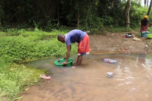 The Water Project: Tombo Lol, next to Agricultural Center -  Collecting Swamp Water