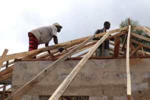 The Water Project: Kamasondo, Feradugu Village -  Men Roofing House