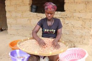 The Water Project: Kamasondo, Feradugu Village -  Woman Processing Ground Nut