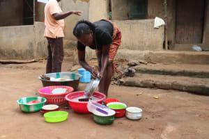 The Water Project: Lungi, Masoila, Lower Kamara St Mosque -  Young Girl Washing Dishes
