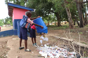 The Water Project: Saint Paul's Roman Catholic Primary School -  Student Throwing Garbage