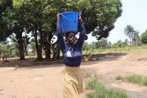 The Water Project: SLMC Primary School -  Student Carrying Water