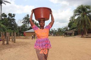 The Water Project: Kamasondo, Raka Village -  Woman Carrying Water