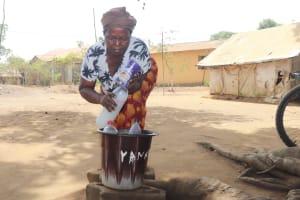 The Water Project: Rotifunk, #4 Abidjan Street -  Woman Selling Palm Wine
