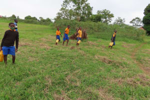 The Water Project: Isagara Primary School -  Students Carrying Water