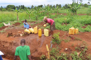 The Water Project: Isagara Primary School -  Carefully Pouring Water