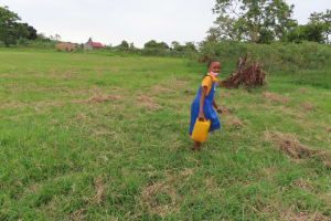 The Water Project: Isagara Primary School -  Carrying Water From The Spring
