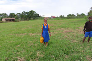The Water Project: Isagara Primary School -  Carrying Water To School