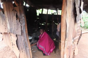 The Water Project: Isagara Primary School -  Woman Preparing Food