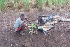 The Water Project: Rwenkole Community -  Boys Preparing Beans