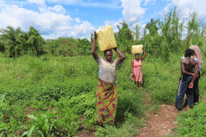 The Water Project: Rwenkole Community -  People Carrying