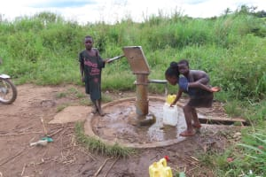 The Water Project: Rwenkole Community -  Children Collecting Water