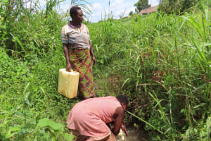 The Water Project: Rwenkole Community -  Collecting Water