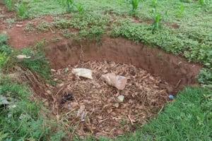 The Water Project: Kyakaitera Community -  Garbage Pit