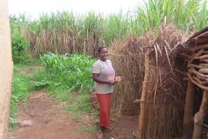 The Water Project: Kyakaitera Community -  Grass Bathing Shelter