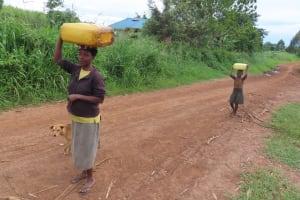 The Water Project: Kyakaitera Community -  Walking Water Home