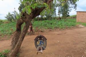 The Water Project: Kyakaitera Kyempisi Community -  Children Swinging
