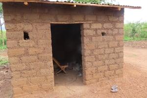 The Water Project: Kyakaitera Kyempisi Community -  Outside Kitchen