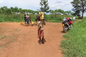 The Water Project: Kikingura Kidwaro Community -  Carrying Water