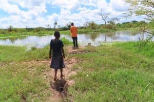 The Water Project: Kikingura Kidwaro Community -  Collecting Water