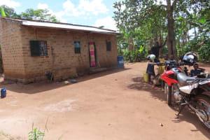 The Water Project: Kikingura Kidwaro Community -  Family In Courtyard