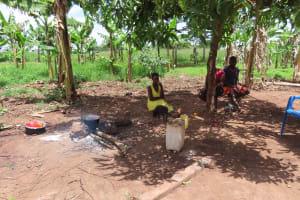 The Water Project: Kikingura Kidwaro Community -  Outside Fire