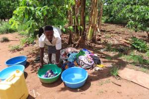 The Water Project: Kikingura Kidwaro Community -  Washing Clothes