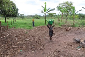 The Water Project: Kyabagabu Community -  Children Carry Water