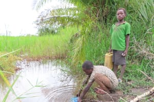 The Water Project: Kyabagabu Community -  Collecting Water