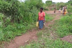 The Water Project: Kyabagabu Community -  Beatrice Nyakake Carries Water Home