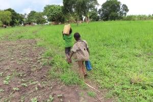 The Water Project: Kyabagabu Community -  Kids Carrying Water