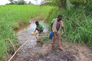 The Water Project: Kyabagabu Community -  Kids Collect Water