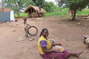 The Water Project: Kyabagabu Community -  Preparing A Meal