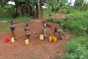 The Water Project: Kiryamasasa Community -  Children Carrying Water