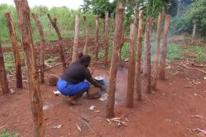 The Water Project: Kiryamasasa Community -  Cooking Outside