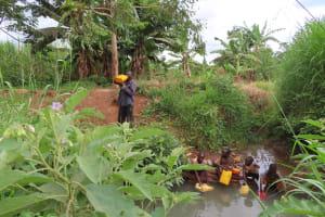 The Water Project: Kiryamasasa Community -  Drinking Open Source Water