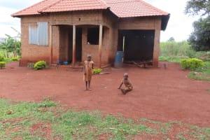 The Water Project: Kiryamasasa Community -  Home Compound