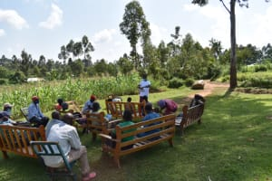 The Water Project: Shianda Community, Akhonya Spring -  Amos Demonstrating Mask Making
