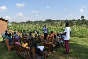 The Water Project: Shianda Community, Akhonya Spring -  Member Addressing The Group