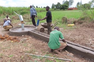 The Water Project: Nsamya Nusaff II Well -  Casting The Apron
