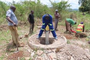 The Water Project: Nsamya Nusaff II Well -  Installation