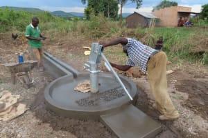 The Water Project: Nsamya Nusaff II Well -  Installing Pump