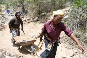 The Water Project: Kaketi Community B -  Hauling Sand