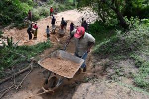 The Water Project: Yumbani Community C -  Ferrying Sand