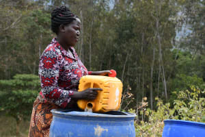 The Water Project: Ivumbu Community B -  Fetching Water To Mix Cement