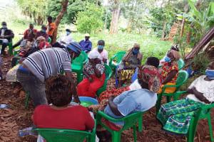 The Water Project: Ivumbu Community B -  Taking Turns Stirring